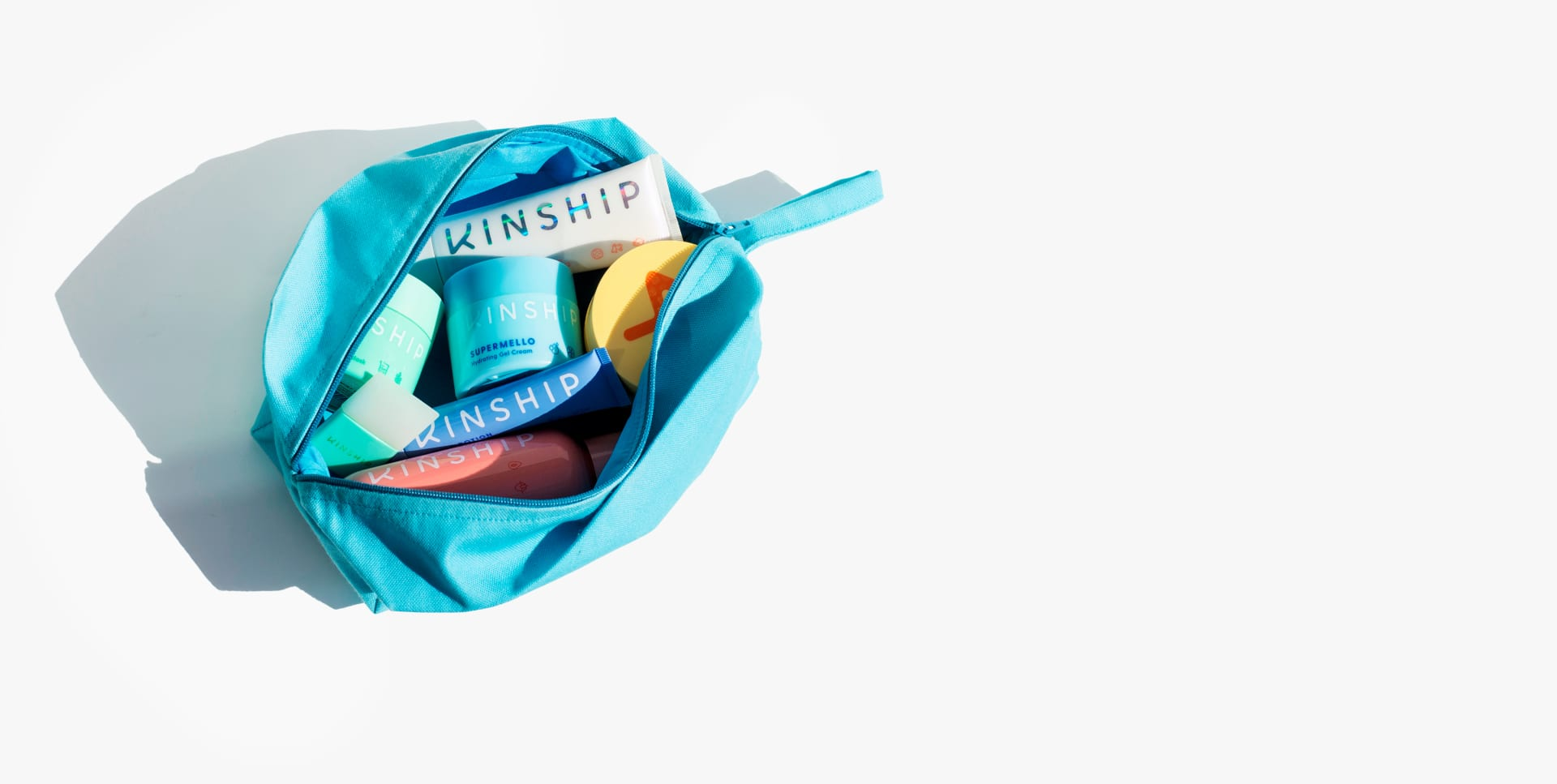 On the Glow Dopp Kit filled with Kinship products