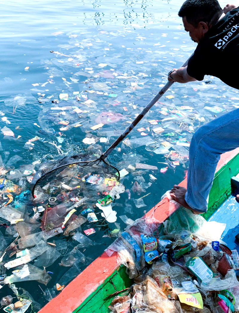 Indonesian fisherman collecting plastic waste from ocean | Kinship