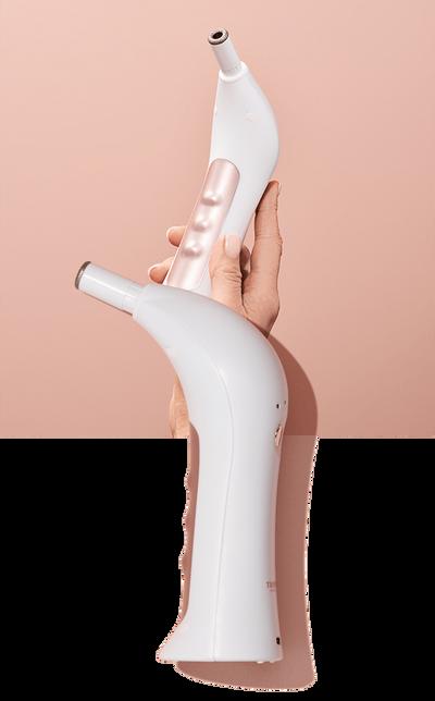 Hand holding RejuvadermDM on pink background