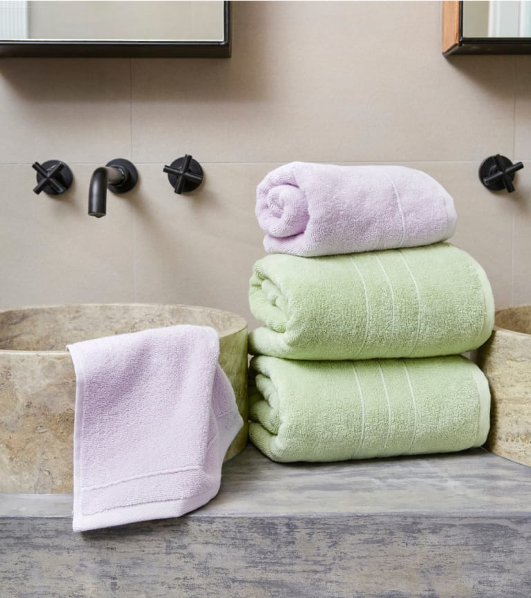 Bathroom sink styled with our latest Super-Plush towel collection featuring Seafoam and Lilac colors