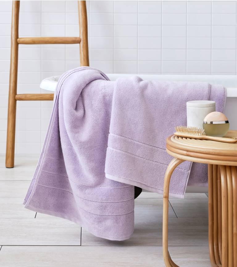 Our Super-Plush Bath Sheet in Lilac draped over a bathtub.