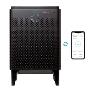 Coway Airmega 400S Graphite next to Cellphone using App to Measure Air Quality