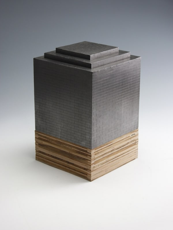 sculpture of rectangular building with stepped top