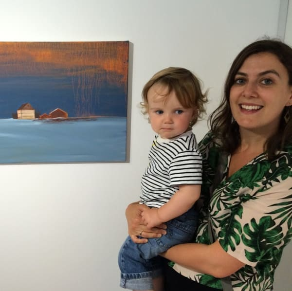 artist catherine knight with her child by one of her paintings