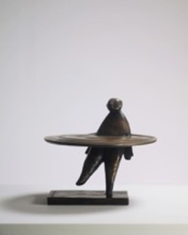 bronze sculpture of a man in a ring