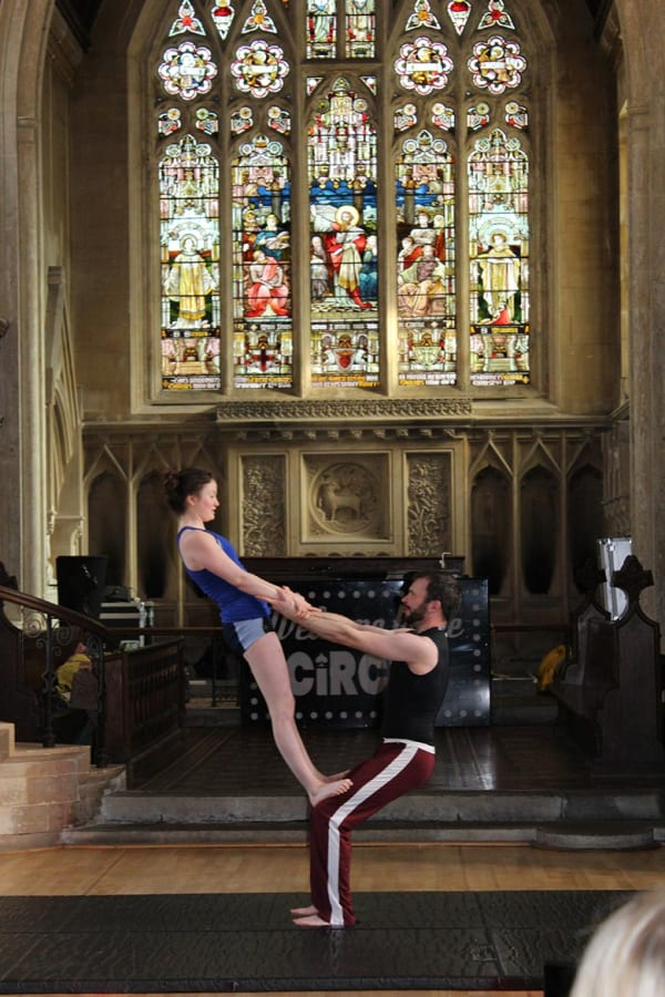 acrobat performers in a church