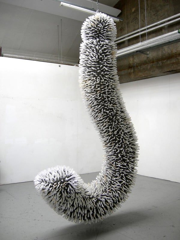 large hanging sculpture in the shape of upside down question mark