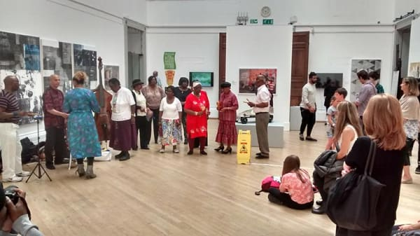 group in RWA gallery during Jamaican Pulse exhibition