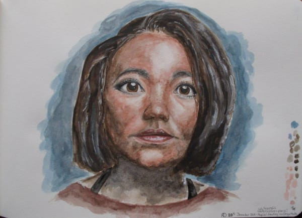 small painting of woman's face