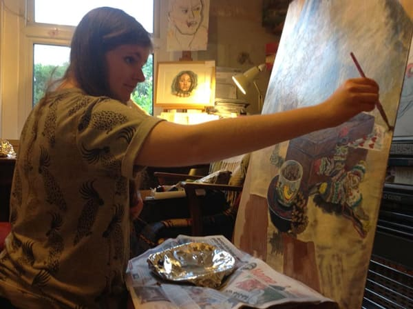 Rhiannon Davies painting at an easel