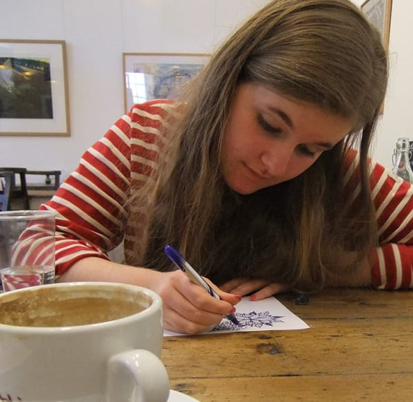 Rhiannon Davies drawing in cafe