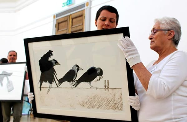 volunteers handle artworks at RWA selection day