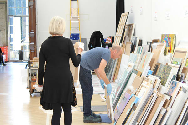 volunteers stack artworks during RWA selection day