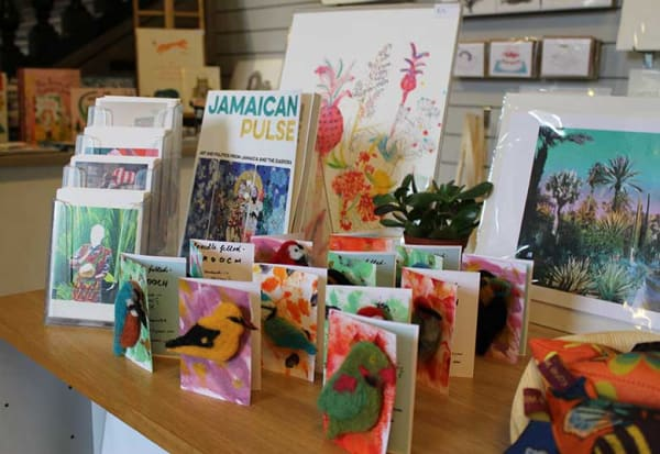 display of children's books and artists' merchandise in RWA shop