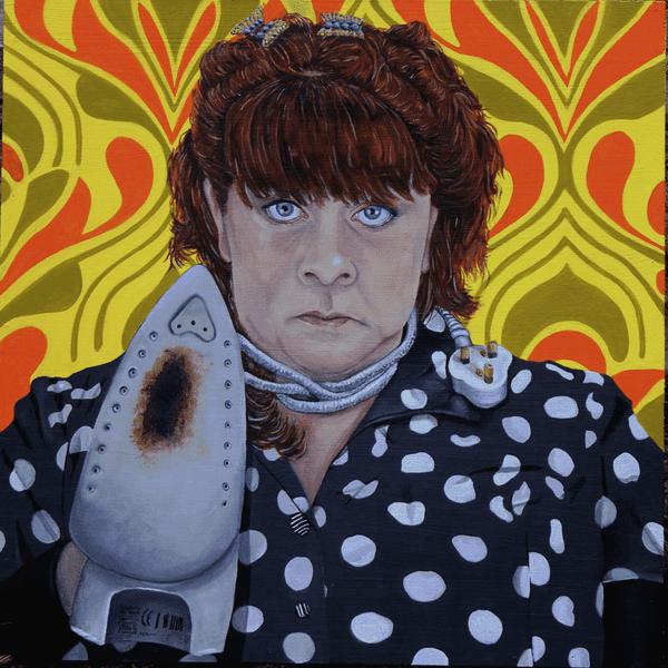 woman holding non-stick iron