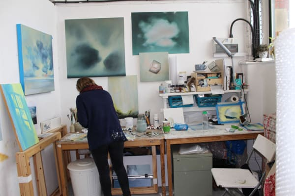 photo of jemma grundon in her studio space at a desk