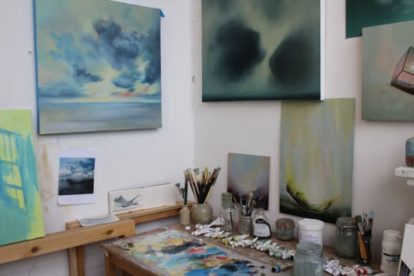 photo of some paintings on a studio wall