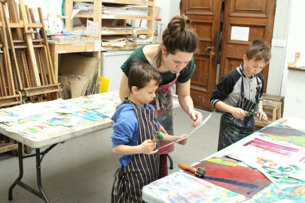 photo of sophie rae helping a boy with his work