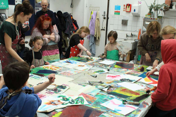 photo of sophie rae and the children in the middle of the workshop