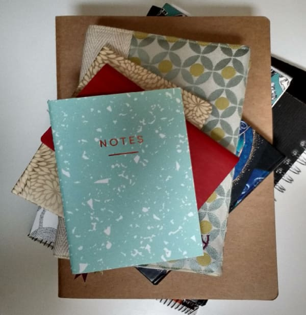 photo of a pile of notebooks