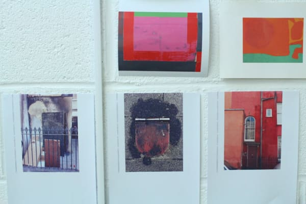 photo of images on the wall of stewart Geddes' studio