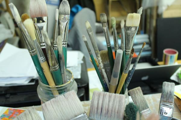 photo of paintbrushes in a jar