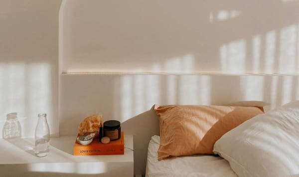 Self-Care Rituals - Sun-drenched bedroom