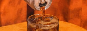 Close up shot of Rootbeer being poured over ice