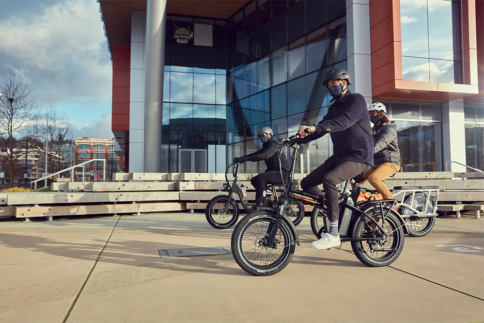 Group of people riding with RadMini 20-inc foldable electric bike