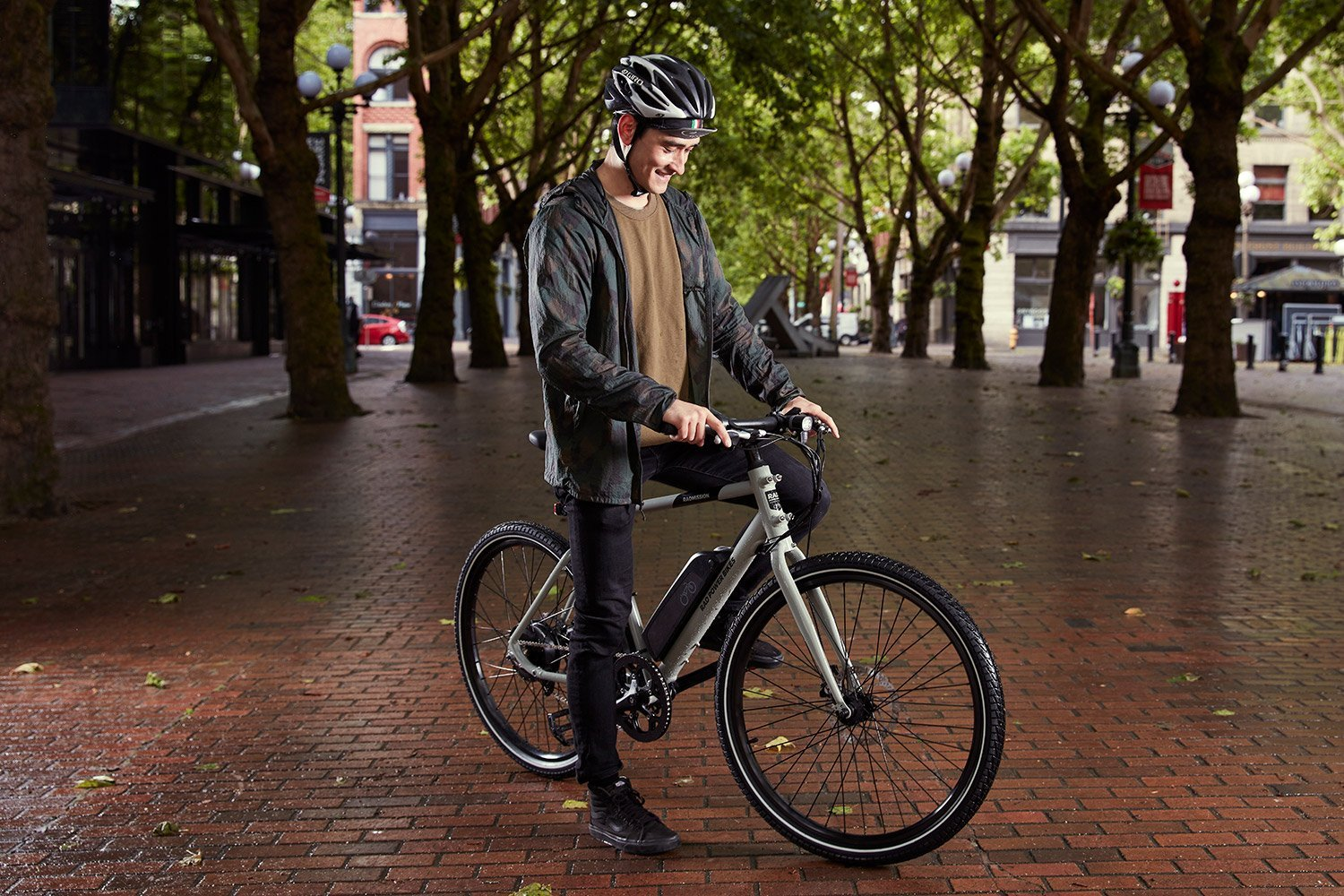 man rides with single geared electric bike by rad power bikes
