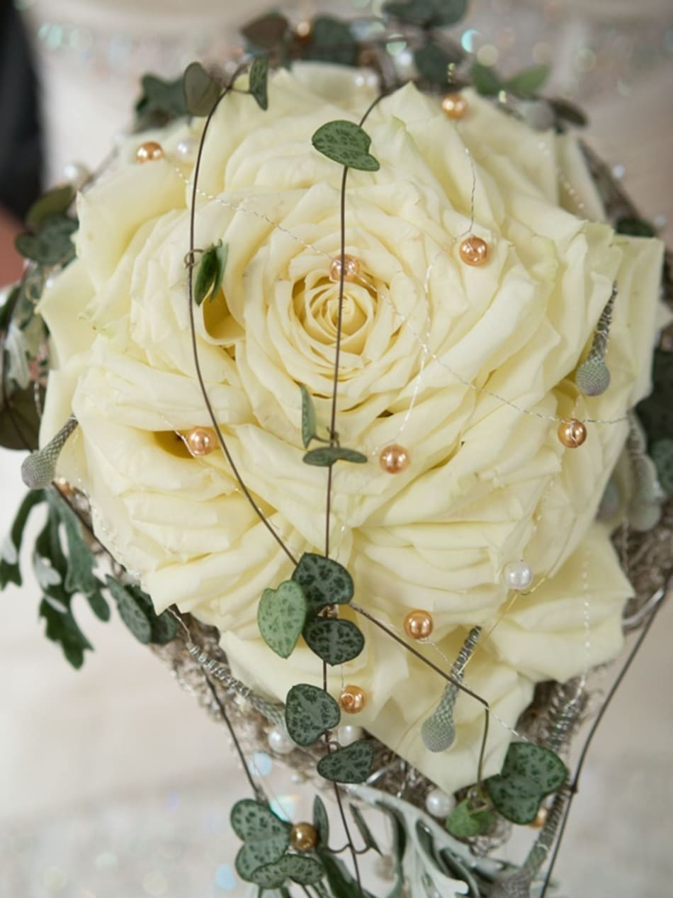 Closeup of bridal bouquet in white.