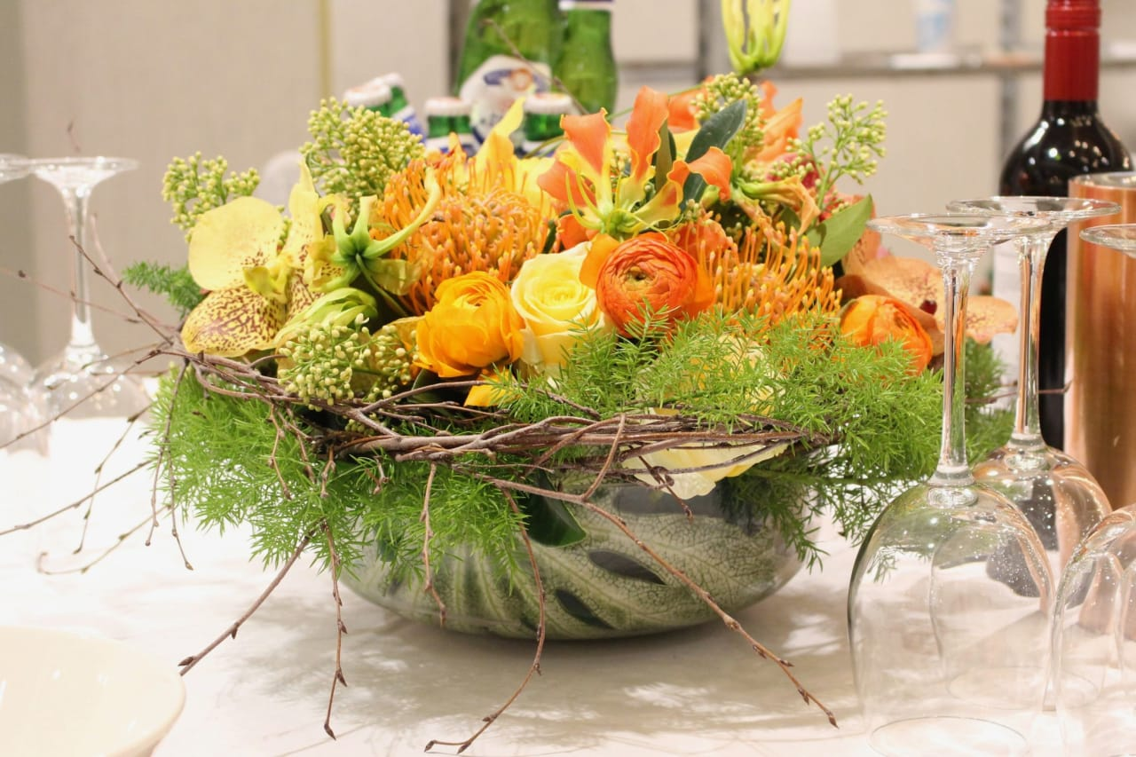 Table setting decorated with flowers.