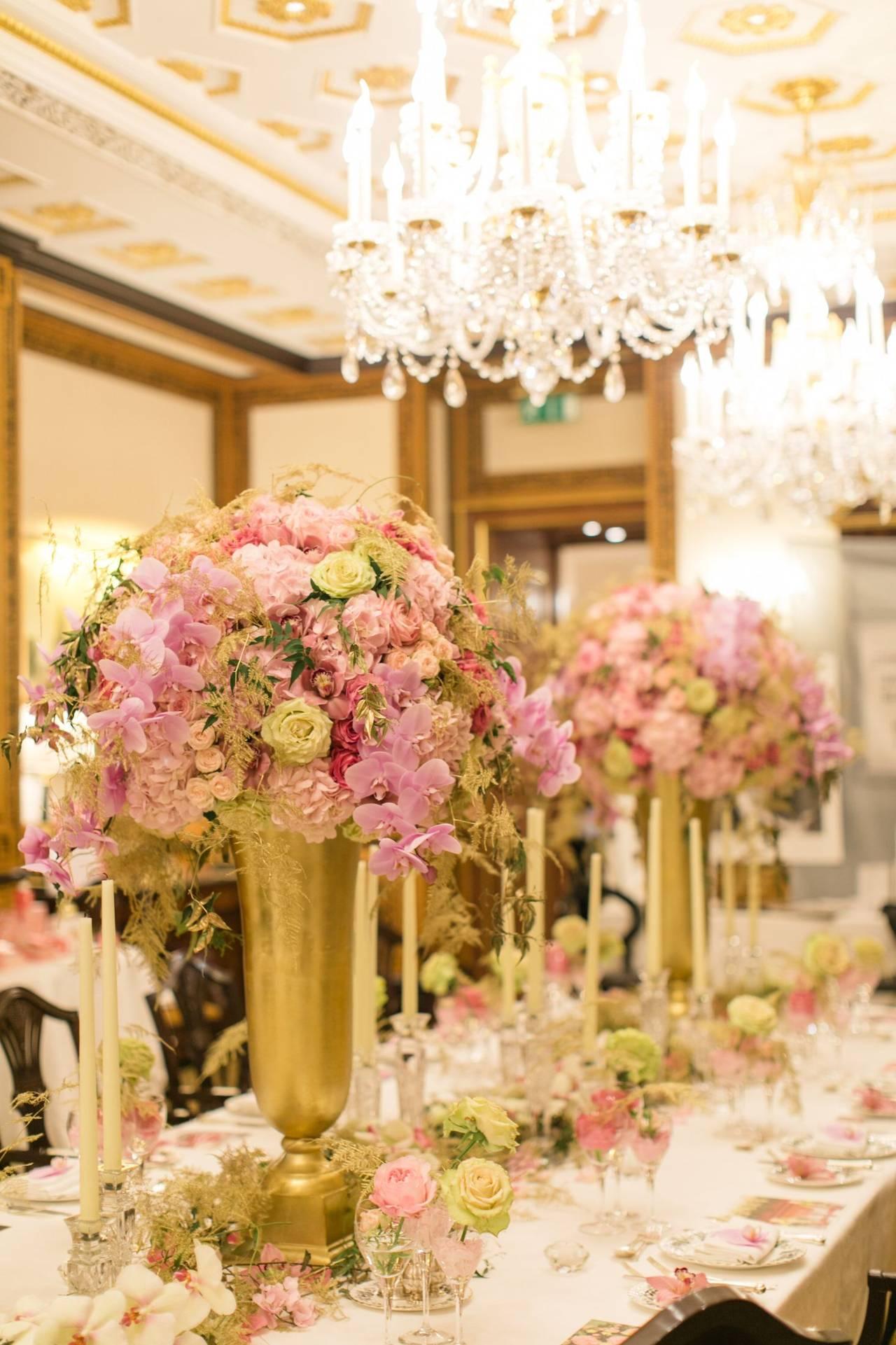 Flower arrangements atop a table.