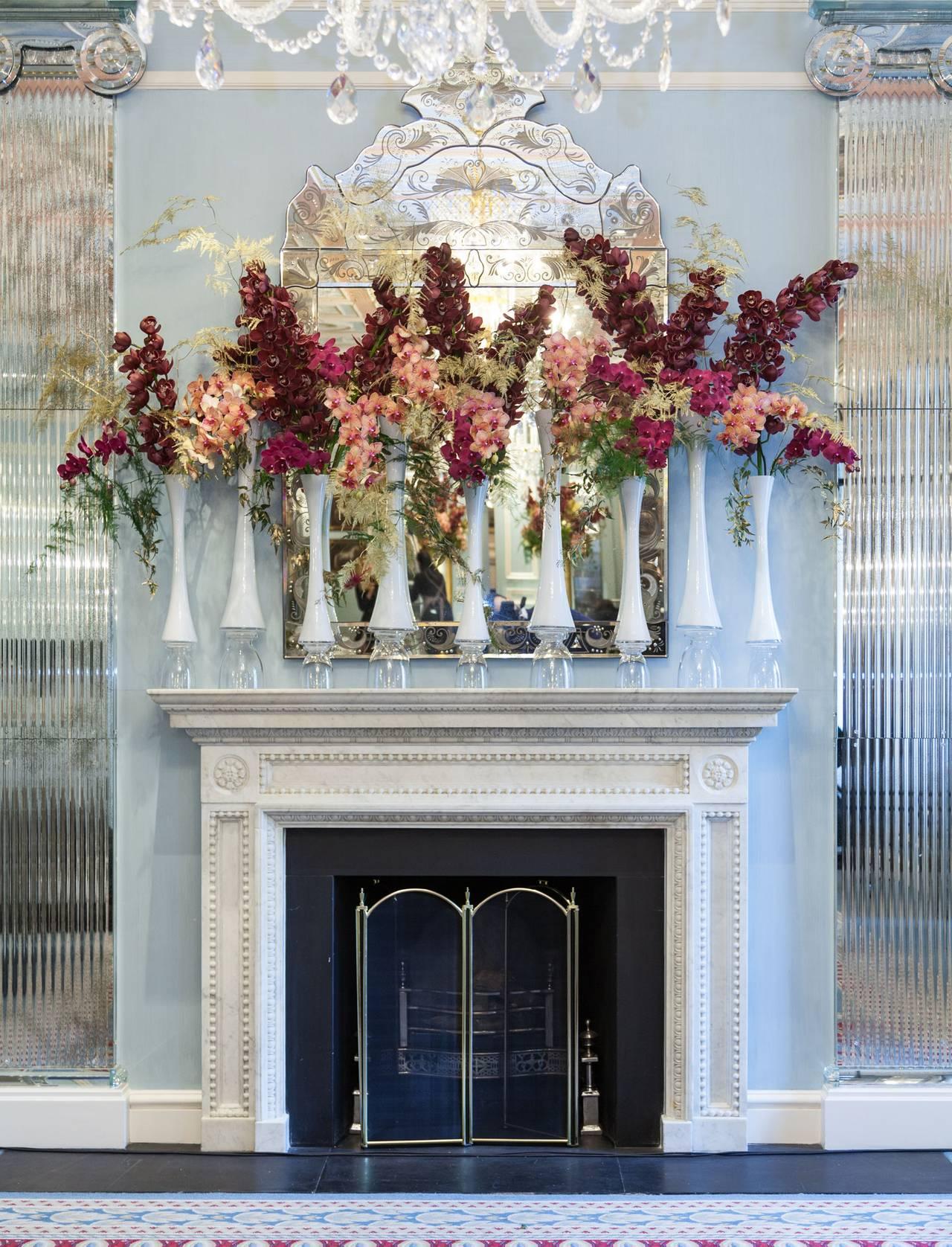 Floral arrangement above fireplace.