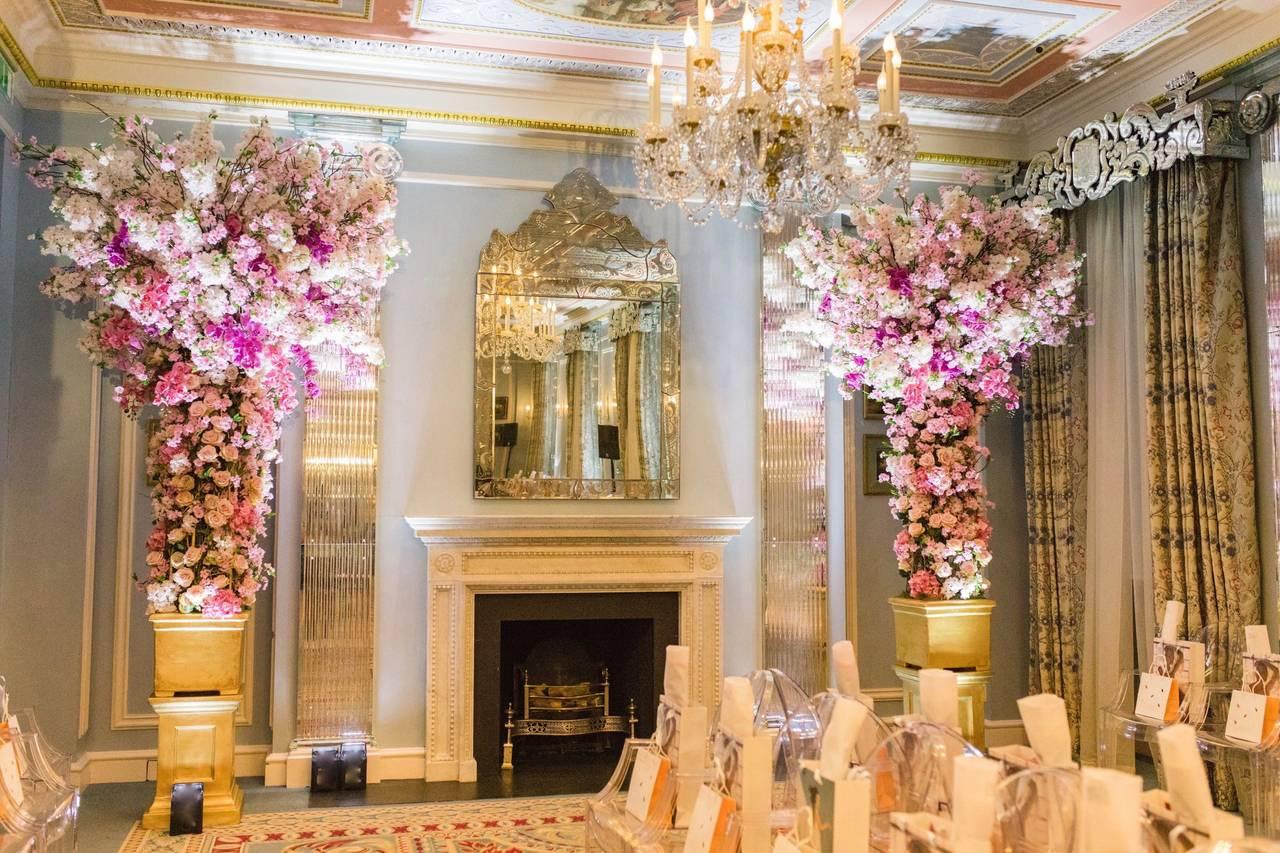 Floral arrangement adjacent to fireplace.