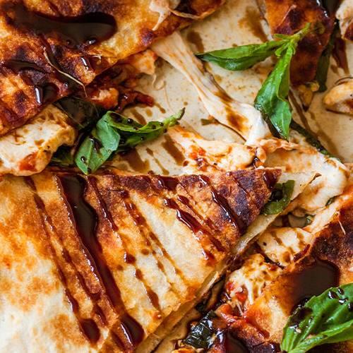 Caprese quesadillas made with Sonoma Gourmet's creamy tomato basil sauce