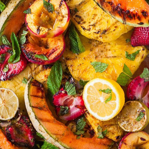 Grilled fruit salad with hot honey made with Sonoma Gourmet's basil parmesan olive oil