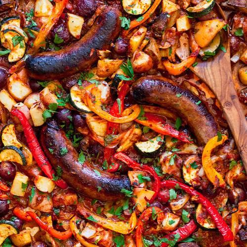 Sheet-pan sausage & veggies made with Sonoma Gourmet's roasted garlic sauce and sauteed garlic olive oil