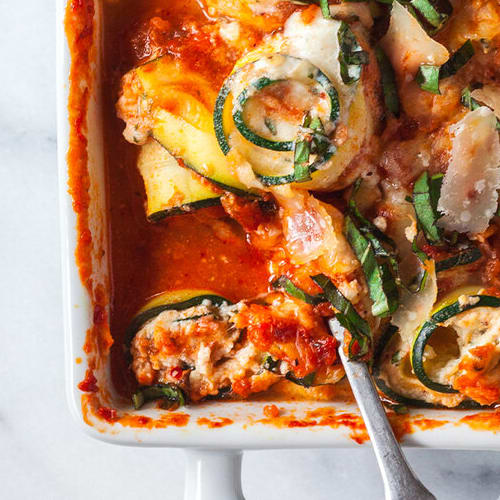 Baked zucchini roll-ups made with Sonoma Gourmet's roasted veggie sauce and basil parmesan olive oil
