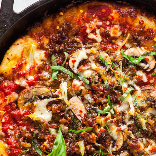 Skillet pan pizza made with Sonoma Gourmet's heirloom tomato pizza sauce and basil parmesan olive oil