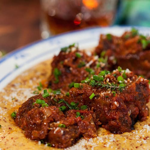 Braised short ribs with polenta made with Sonoma Gourmet's cherry tomato basil sauce and basil parmesan olive oil