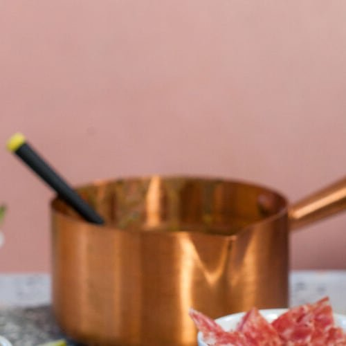 Kale pesto white cheddar fondue made with Sonoma Gourmet's kale pesto white cheddar sauce