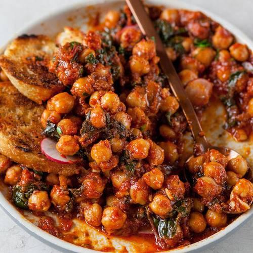 Tomato-braised chickpeas made with Sonoma Gourmet's plum tomato marinara sauce and sauteed garlic olive oil