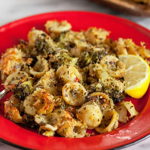 Spicy broccoli pasta made with Sonoma Gourmet's kale pesto white cheddar sauce and sauteed garlic olive oil