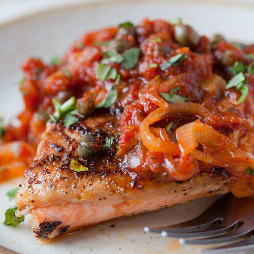 Pan-roasted salmon with tomato sauce made with Sonoma Gourmet's roasted garlic sauce
