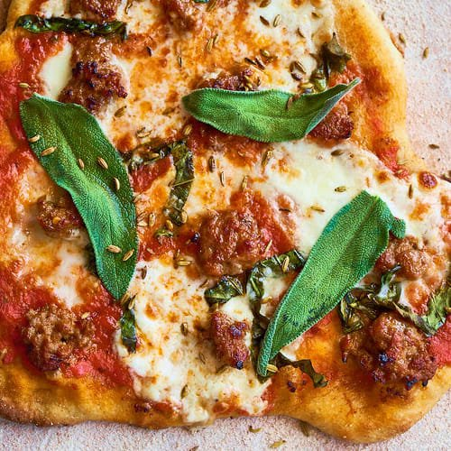 Burrata, sage & sausage pizza made with Sonoma Gourmet's heirloom tomato pizza sauce and basil parmesan olive oil