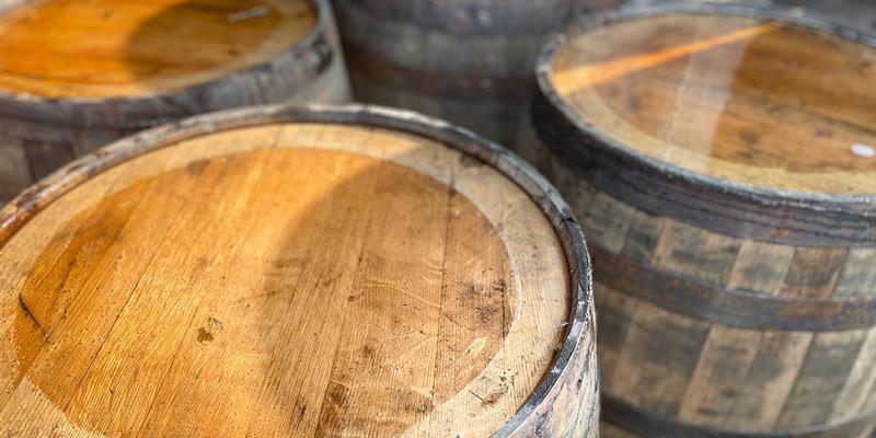 Three used whiskey barrels
