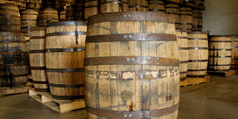 Whiskey barrels on pallets in warehouse
