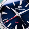 Grand Seiko SBGN005 - macro detail of blue dial with red accents.