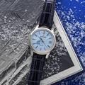 Grand Seiko SBGA407 watch with blue Snowflake dial and crocodile strap.